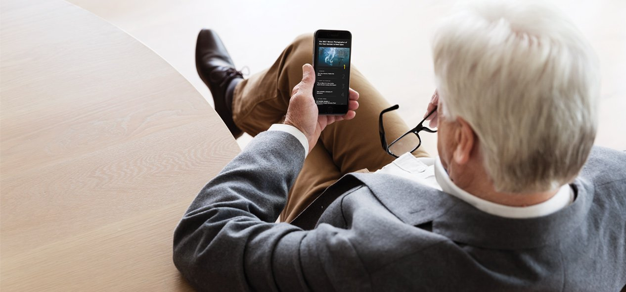 Senior man using smartphone app