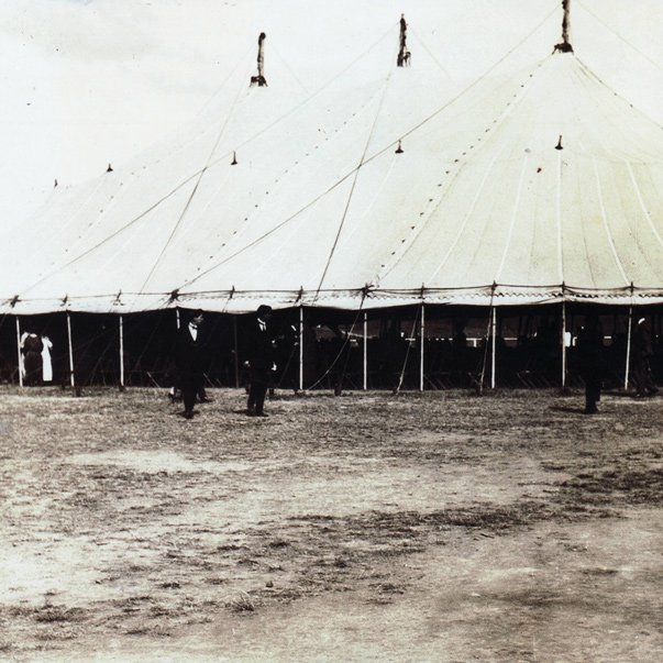 Black and white archive image of large meeting tents. Pavilions Blackburn Lake is built on a historic site owned by the Seventh Day Adventist Church.
