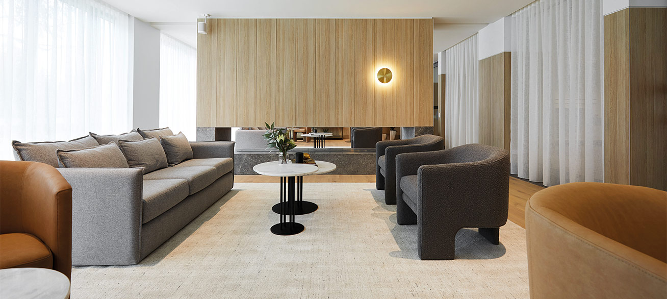 Elegant shared lounge area with open fire at Pavilions Blackburn Lake