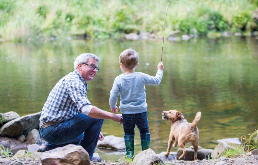 Senior man with young boy and dog playing beside a river. Enjoy the natural environment with Blackburn Lake Sanctuary across the road and many parks nearby.